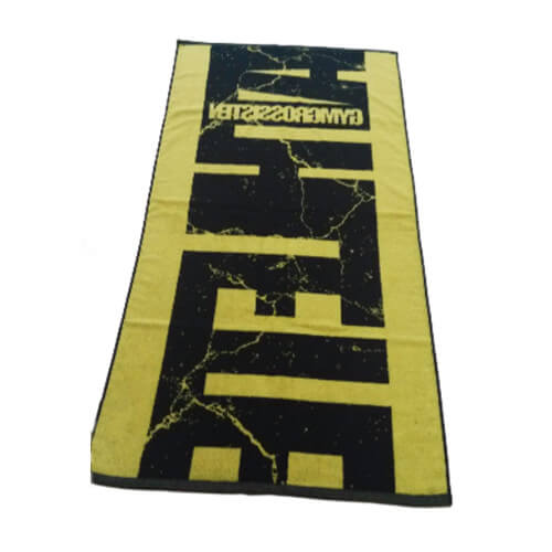 back view of jacquard bath towel in black and yellow