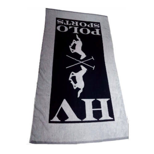front view of jacquard beach towel in white and navy